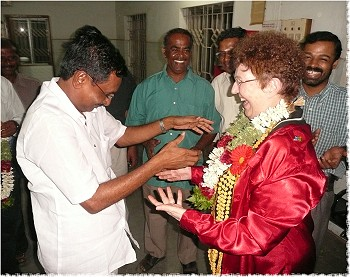 District Governor L Narayanaswamy greets District Governor Marlene Brown in Tirupur, India