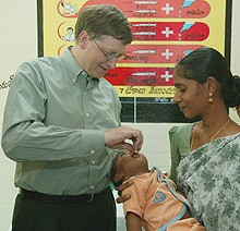 Bill Gates, co-founder of the Bill & Melinda Gates Foundation, gives a baby the oral polio vaccine